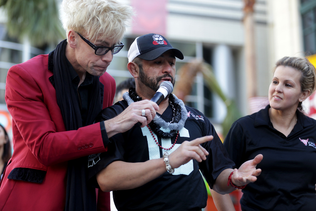 Contestant Hared Grajeda talks about his bloody mary as Emcee Murray Sawchuck holds the mic at the inaugural National Hangover Day Cocktail Competition at the LINQ Promenade on Sunday, January 1,  ...