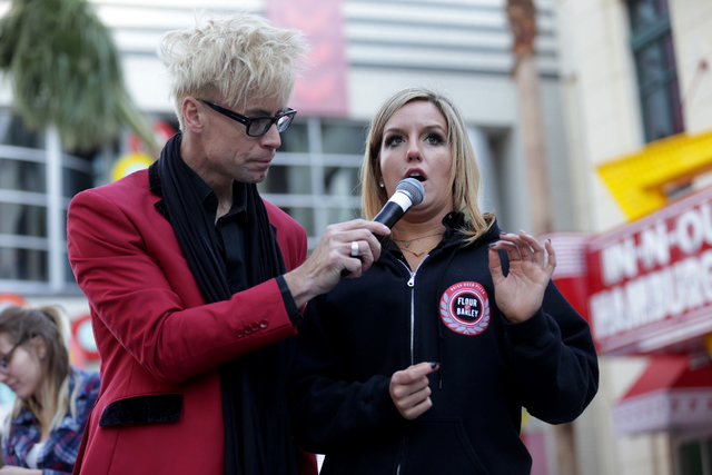 Contestant Leah Parr talks about his bloody mary as Emcee Murray Sawchuck holds the mic at the inaugural National Hangover Day Cocktail Competition at the LINQ Promenade on Sunday, January 1, 2017 ...
