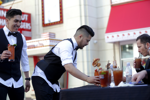 Contestant Julian Liwanag sets a bloody mary before the judges at the inaugural National Hangover Day Cocktail Competition at the LINQ Promenade on Sunday, January 1, 2017, in Las Vegas. (Rachel A ...