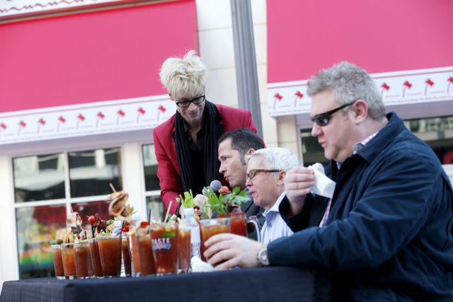 Emcee Murray Sawchuck talks to the judges at the inaugural National Hangover Day Cocktail Competition at the LINQ Promenade on Sunday, January 1, 2017, in Las Vegas. (Rachel Aston/Las Vegas Review ...