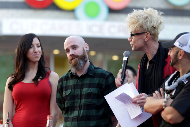 """Emcee Murray Sawchuck talks contestants Anji """"Yoshi"""" Hastings and Jesse Barrettat the inaugural National Hangover Day Cocktail Competition at the LINQ Promenade on Sunday, Januar ..."""