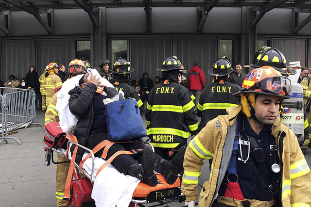 An injured passenger is taken from Atlantic Terminal in the Brooklyn borough of New York after a Long Island Rail Road train hit a bumping block, Wednesday, Jan. 4, 2017. (Mark Lennihan/AP)