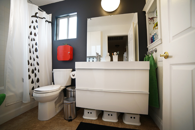 COURTESY After: The Ikea design team gave this bathroom a makeover that included a long sink with two faucets and a cabinet with two large, deep drawers. Three stools, tucked underneath the cabine ...