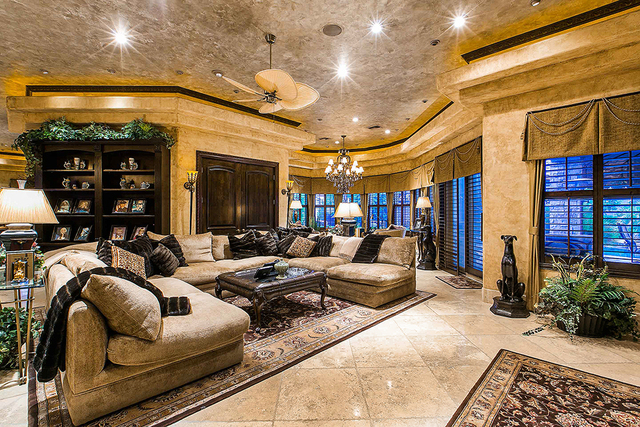 The main residence is a 16,462-square-foot home with five bedrooms and eight baths. It has a traditional Old-World style, masterful design and high-quality craftsmanship throughout, the one-of-a-k ...