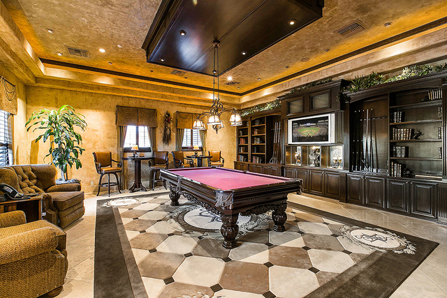 The billiard room is in a private sitting area in the main home. (Courtesy)