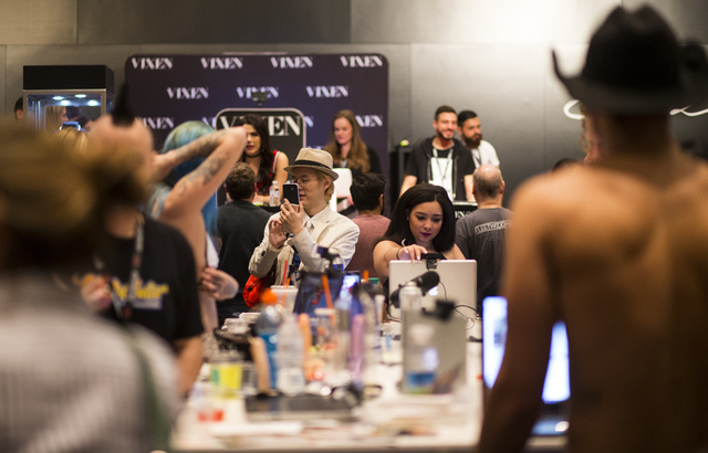 An attendee takes a photo during the AVN Adult Entertainment Expo at Hard Rock hotel-casino in Las Vegas on Thursday, Jan. 19, 2017. (Chase Stevens/Las Vegas Review-Journal) @csstevensphoto