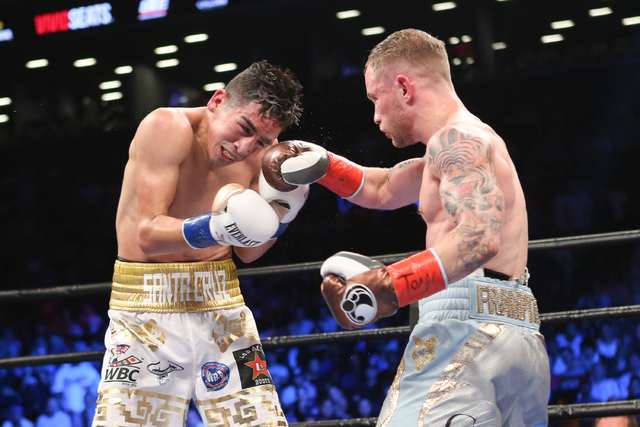 Carl Frampton, right, lands a punch on Leo Santa Cruz during their WBA Super World Featherweight Championship fight at the Barclays Center in the Brooklyn borough of New York on Saturday, July 30, ...