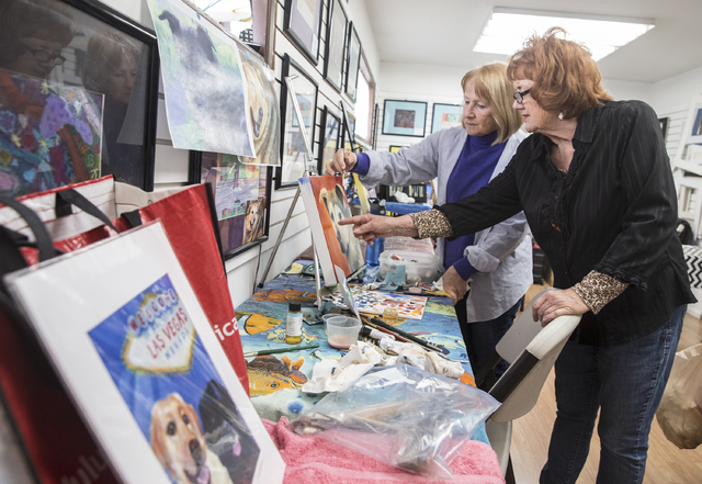 Instructor Georgia Lawson, right, helps Lucia Sullivan with a painting of Sullivan's Siberian husky-German shepherd mix during a pet portrait class on Thursday at City Lights Art Gallery in Hender ...
