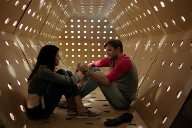 """Annie (Meera Rohit Kumbhani) and Dave (Nick Thune) take a break to rest inside the maze in """"Dave Made a Maze."""" (Courtesy photo)"""