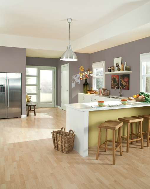 COURTESY Poised Taupe, Sherwin-Williams' Color of the Year, works well in a kitchen that has white cabinets.