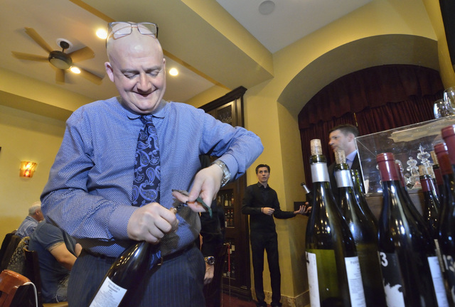 """Sommelier Paolo Uccellatori uncorks a bottle of wine during the """"Taste and Learn"""" event at Ferraro's Italian Restaurant and Wine Bar at 4480 Paradise Road in Las Vegas on Saturday, O ..."""