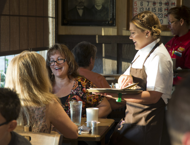Lauren Bateman, right, takes food orders from Jacquelynn Nickler, center, and Holly Crone during the grand opening of Las Vegas' first Cracker Barrel location near the Silverton Hotel-Casino on Mo ...