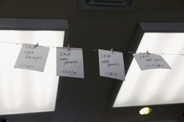 Notes hang in resemblance of people who have received a DACA permit at the Rafael Rivera Community Center on Tuesday, Jan. 24, 2017, in Las Vegas. Luna is a DACA recipient himself and enjoys helpi ...