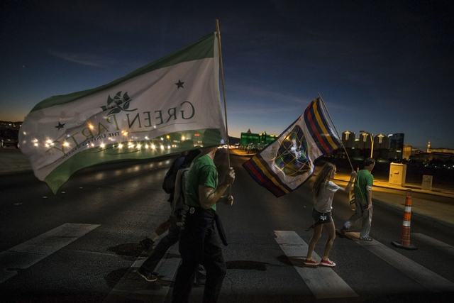 Members of the Nevada Green Party march north on Paradise Road while the third and final presidential debate takes place at the Thomas & Mack Center on Wednesday, Oct. 19, 2016, in Las Vegas.  ...
