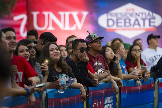 People gather to watch a live CNN newscast ahead of the third presidential debate at UNLV in Las Vegas on Tuesday, Oct. 18, 2016. (Chase Stevens/Las Vegas Review-Journal) @csstevensphoto