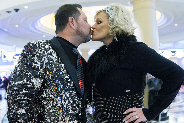 Arleen Arzola and Arthur Ortega share a kiss in the lobby of the Venetian hotel-casino on New Year's Eve in Las Vegas. (Benjamin Hager/Las Vegas Review-Journal)
