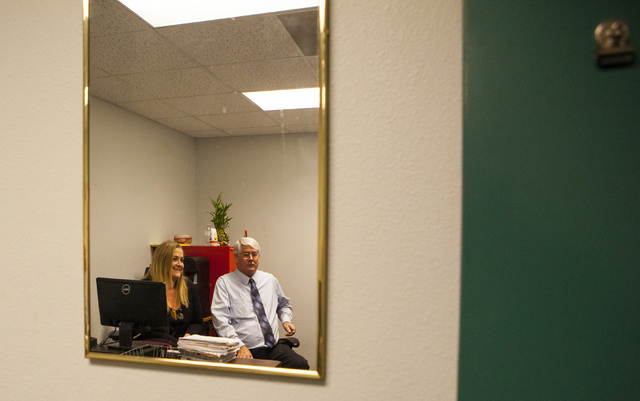Kim Kampling, court administrator for the Las Vegas Justice Court, left, and DMV Public Information Officer Kevin Malone at the DMV's Flamingo Road location in Las Vegas on Wednesday, Jan. 25, 201 ...