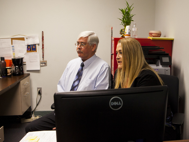 DMV Public Information Officer Kevin Malone, left, and Kim Kampling, court administrator for the Las Vegas Justice Court, at the DMV's Flamingo Road location in Las Vegas on Wednesday, Jan. 25, 20 ...