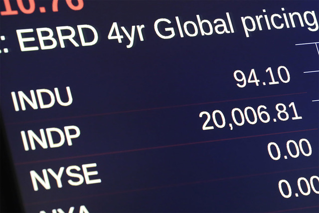 A board above the trading floor of the New York Stock Exchange shows the Dow Jones industrial average at the opening bell, Wednesday, Jan. 25, 2017. (Richard Drew/AP)