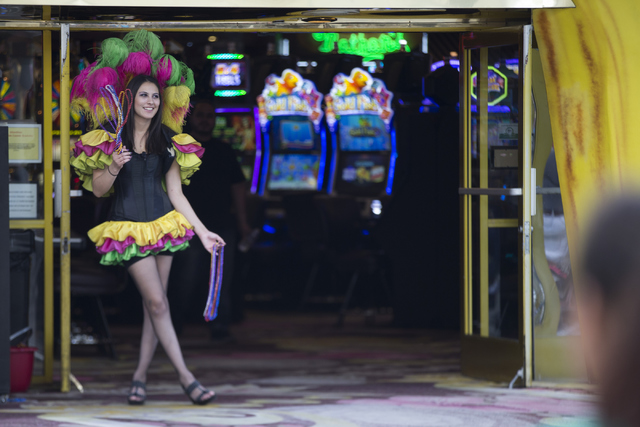 Hostess Mildred Marissa Herrera stands in front of Mermaids casino at the Fremont Street Experience on Thursday, April 21, 2016, in Las Vegas. The owners of the D Las Vegas and Golden Gate purchas ...