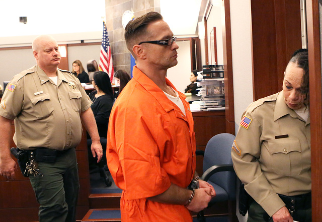Two-time killer Scott Dozier leaves the courtroom after his hearing at the Regional Justice Center on Thursday, Jan. 19, 2017, in Las Vegas. Dozier, who is on death row, is asking a judge to force ...