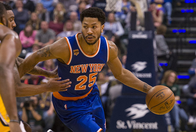 New York Knicks guard Derrick Rose (25) drives the ball into the Indiana Pacer's defense during the first half of an NBA basketball game, Saturday, Jan. 7, 2017, in Indianapolis. (AP Photo/Doug Mc ...