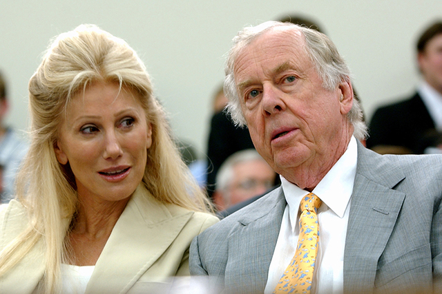 In this July 25, 2006, photo, Oklahoma energy tycoon T. Boone Pickens, right, with his wife, Madeleine, appear at a House Energy and Commerce subcommittee hearing on Capitol Hill in Washington. A  ...
