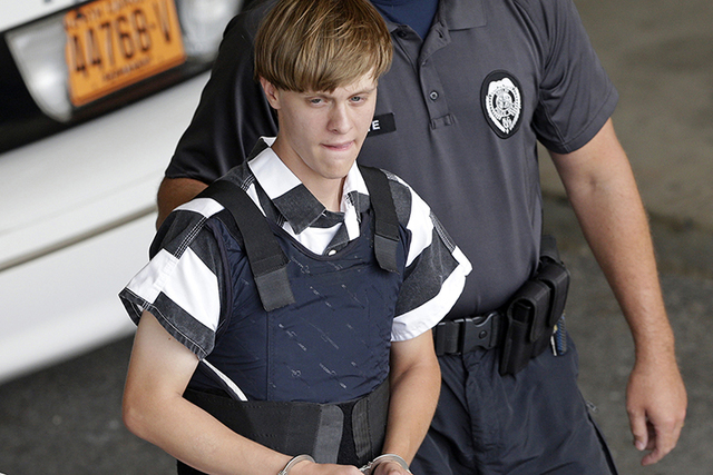 In this June 18, 2015 file photo, Charleston, S.C., shooting suspect Dylann Storm Roof is escorted from the Cleveland County Courthouse in Shelby, N.C. (Chuck Burton/AP)