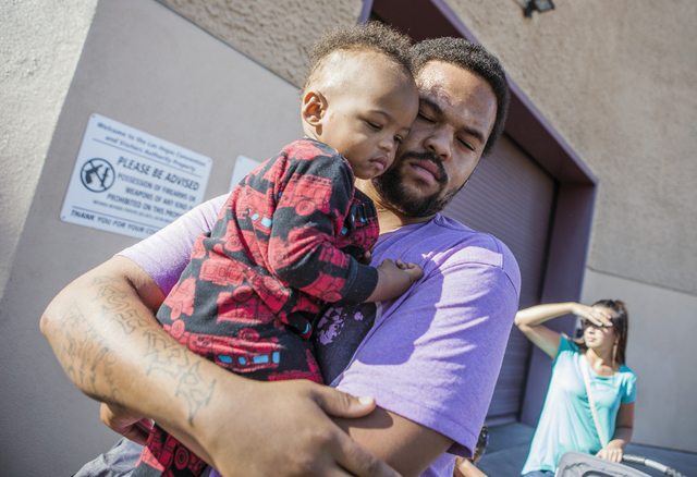 Shawn Hutchings holds his one-year old son Alonzo,  while standing in line during Project Homeless Connect at Cashman Center on Tuesday, Nov., 15, 2016. His family has the Affordable Health Care p ...