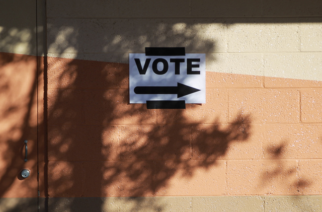 A sign directs voters at Neighborhood Recreation Center in North Las Vegas on Tuesday, Nov. 8, 2016. (Chase Stevens/Las Vegas Review-Journal Follow @csstevensphoto)