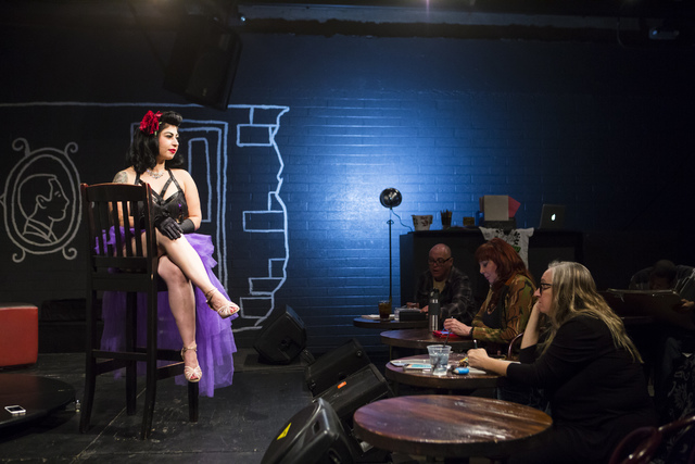 Diana Hicks, left, poses for artists during a monthly drawing session held by Dr. Sketchy's Anti-Art School at Artifice in downtown Las Vegas on Thursday, Nov. 17, 2016. Chase Stevens/Las Vegas Re ...