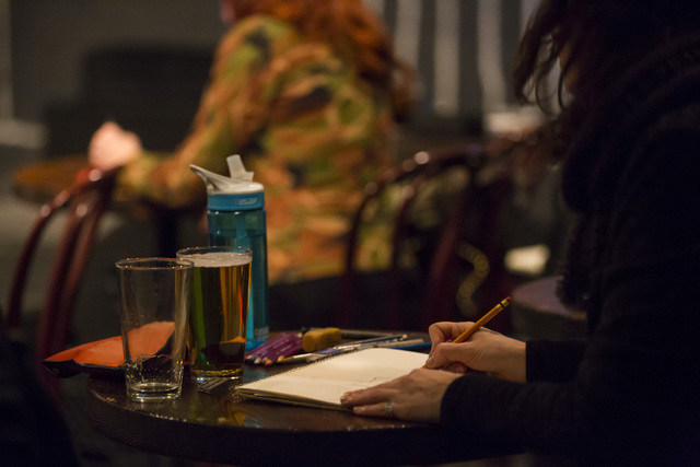 People sketch during a monthly drawing session held by Dr. Sketchy's Anti-Art School at Artifice in downtown Las Vegas on Thursday, Nov. 17, 2016. Chase Stevens/Las Vegas Review-Journal Follow @cs ...