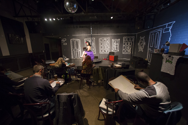 DeArdis Hurts, right, sketches during a monthly drawing session held by Dr. Sketchy's Anti-Art School at Artifice in downtown Las Vegas on Thursday, Nov. 17, 2016. Chase Stevens/Las Vegas Review-J ...