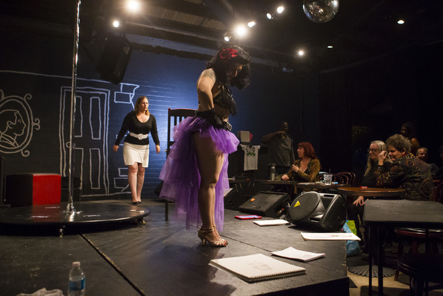 Diana Hicks, center, looks at sketches portraying her during a monthly drawing session held by Dr. Sketchy's Anti-Art School at Artifice in downtown Las Vegas on Thursday, Nov. 17, 2016. Chase Ste ...