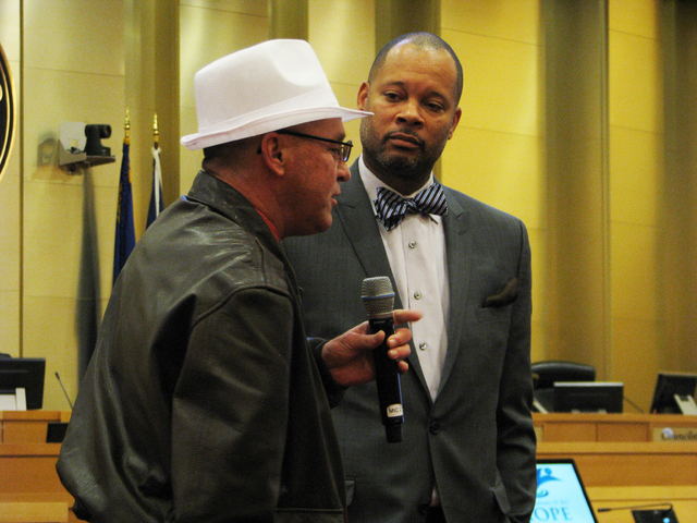 Michael Deaman speaks to Nevada Senate Majority Leader Aaron D. Ford  the H.O.P.E. Court graduation on Jan. 19, 2017 at the Las Vegas City Hall Council Chambers. Formerly homeless Deaman was one o ...