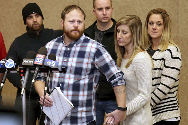 Family spokesman David Boyd and others hold a news conference Thursday, Jan. 5, 2017, in Crystal Lake, Illinois, after an 18-year-old man was assaulted in Chicago earlier this week. (Patrick Kunze ...