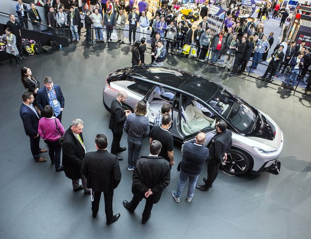 People view Faraday Future's new concept car during CES 2017 in the Las Vegas Convention Center on Friday, Jan. 06, 2017. Around 175,000 people are expected the attend the world's largest consumer ...