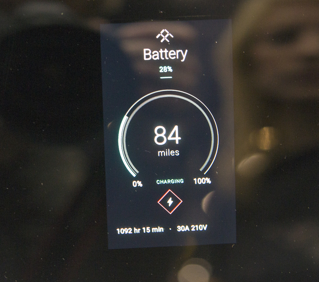 The battery life indicator lights up on the driver's side window on Faraday Future's new concept car during CES 2017 in the Las Vegas Convention Center on Friday, Jan. 06, 2017. Around 175,000 peo ...