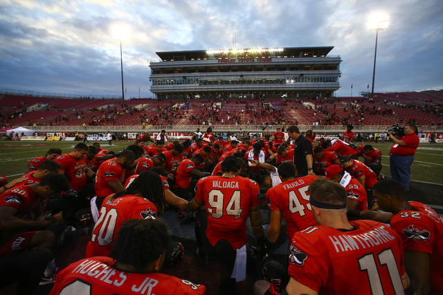 UNLV players huddle after defeating Wyoming 69-66 in a triple overtime football game at Sam Boyd Stadium in Las Vegas on Saturday, Nov. 12, 2016. (Chase Stevens/Las Vegas Review-Journal) Follow @c ...