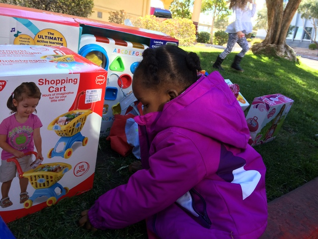Penelope Cole checks out the toys Jan. 9, 2016, which were brought by Operation Fire Holiday Emergency Assistance Team (H.E.A.T.) (JAN HOGAN/LAS VEGAS REVIEW-JOURNAL)