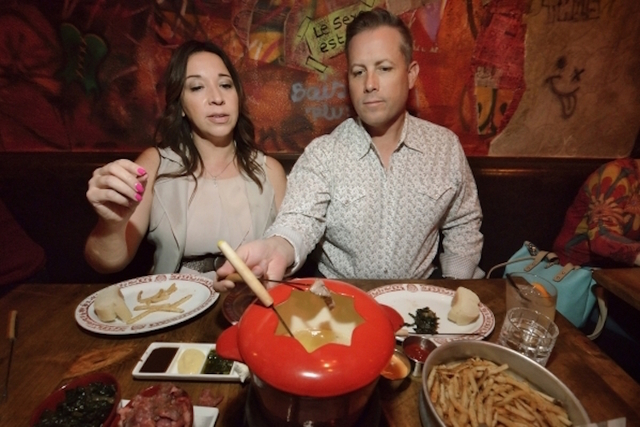 Tyra Bell-Holland and Rob Holland have steak fondue at F. Pigalle at 508 Fremont St. in Las Vegas on Saturday, Feb. 13, 2016. Bill Hughes/Las Vegas Review-Journal