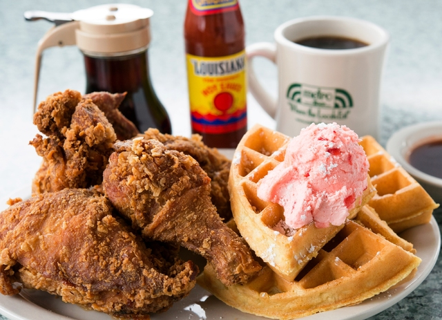 Fried chicken and a Belgian waffle topped with strawberry butter is one of Metro Diner's breakfast items. (Metro Diner)