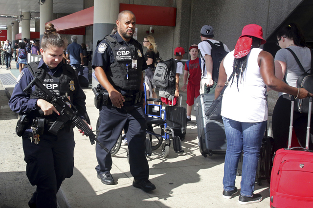 A heavy police presence was at the Ft. Lauderdale-Hollywood International Airport after it re-opened Saturday, Jan. 7, 2017. Investigators continued their work downstairs in the baggage area of te ...