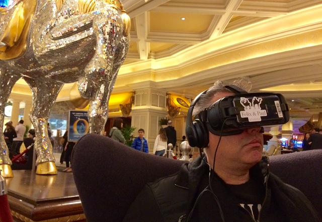 """Ronald Figueira, from Venezuela, checks out a virtual-reality film of """"O"""" in the Bellagio lobby. (Mike Weatherford/Review-Journal."""