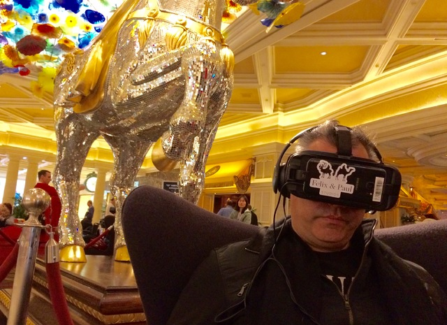 """Ronald Figueira, from Venezuela, checks out a virtual-reality film of """"O"""" in the Bellagio lobby. (Mike Weatherford/Review-Journal)"""