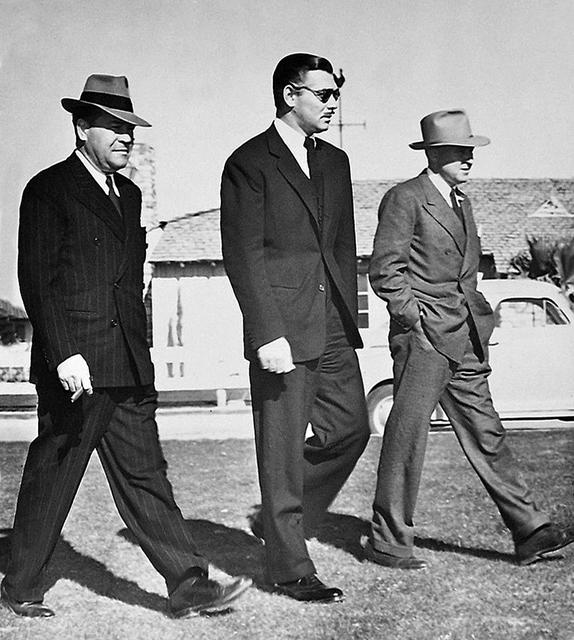 MGM Vice President Eddie Mannix, a shell-shocked Clark Gable, and Gable's close friend Al Menasco at the El Rancho in Las Vegas on Jan. 19, 1942. (Courtesy of Robert Matzen)