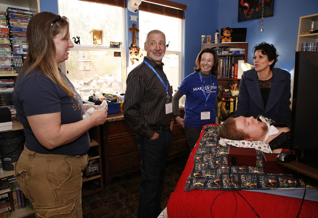 Sandy Gardner speaks with Make-A-Wish Southern Nevada volunteers Dave Reznin, Barbara Tapp and CEO Caroline Ciocca at son Cashel Gardner's bedside at their family home, Thursday, Jan. 12, 2017, in ...