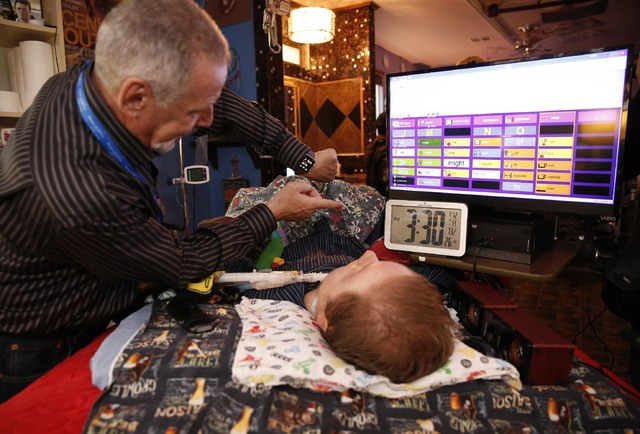 Make-A-Wish Southern Nevada volunteer Dave Revzin shows Cashel Gardner his watch at the Gardner family home, Thursday, Jan. 12, 2017, in Las Vegas. Make-A-Wish Southern Nevada and its partners for ...