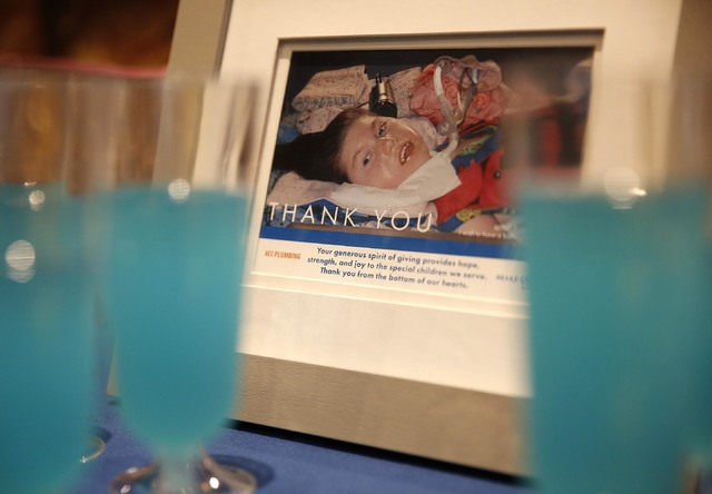 A framed image of Allie Gardner sits on a reception table at the Gardner family home, Thursday, Jan. 12, 2017, in Las Vegas. Make-A-Wish Southern Nevada and its partners formally revealed the Gard ...