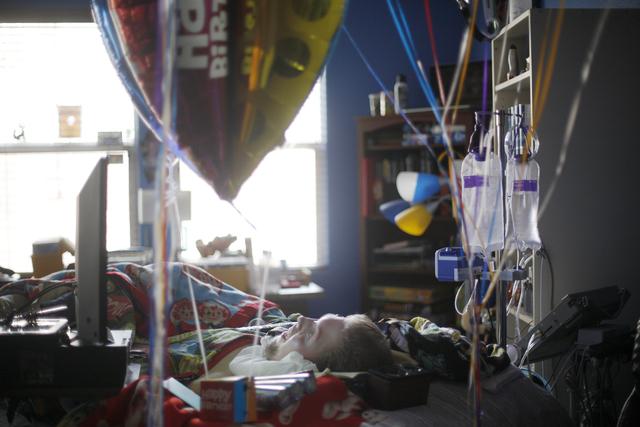 Cashel Gardner lies in his bed in his home on Tuesday, Jan. 10, 2017. He has spinal muscular atrophy. (Rachel Aston/Las Vegas Review-Journal) @rookie__rae